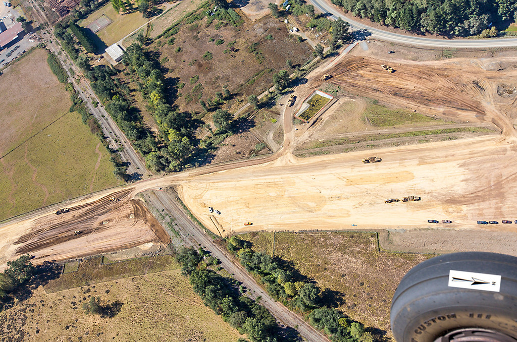 Description of . The northern interchange where it will cross the railroad. Willits bypass construction overflight Sept. 5; Pilot Mike Smith; photographer Steve Eberhard/TWN