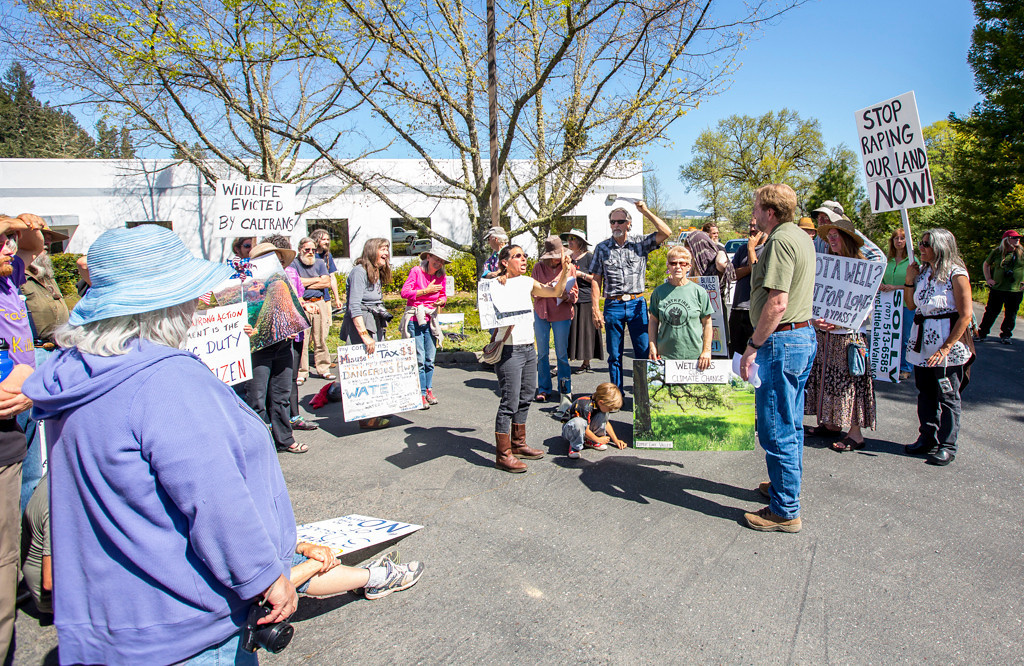 Description of . Photo by Steve Eberhard TWN 12 Willits bypass protesters April 23, 2013 in front of the Willits CalTrans bypass project office at corner of Baechtel and E. Hill roads.