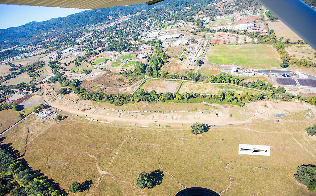 Description of . The viaduct portion of the bypass route, note the footings for the viaduct and the Willits sewer plant. Willits bypass construction overflight Sept. 5; Pilot Mike Smith; photographer Steve Eberhard/TWN