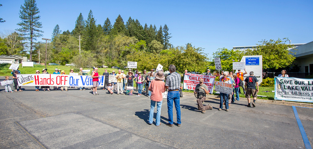 Description of . Photo by Steve Eberhard TWN 2 Willits bypass protesters April 23, 2013 in front of the Willits CalTrans bypass project office at corner of Baechtel and E. Hill roads.