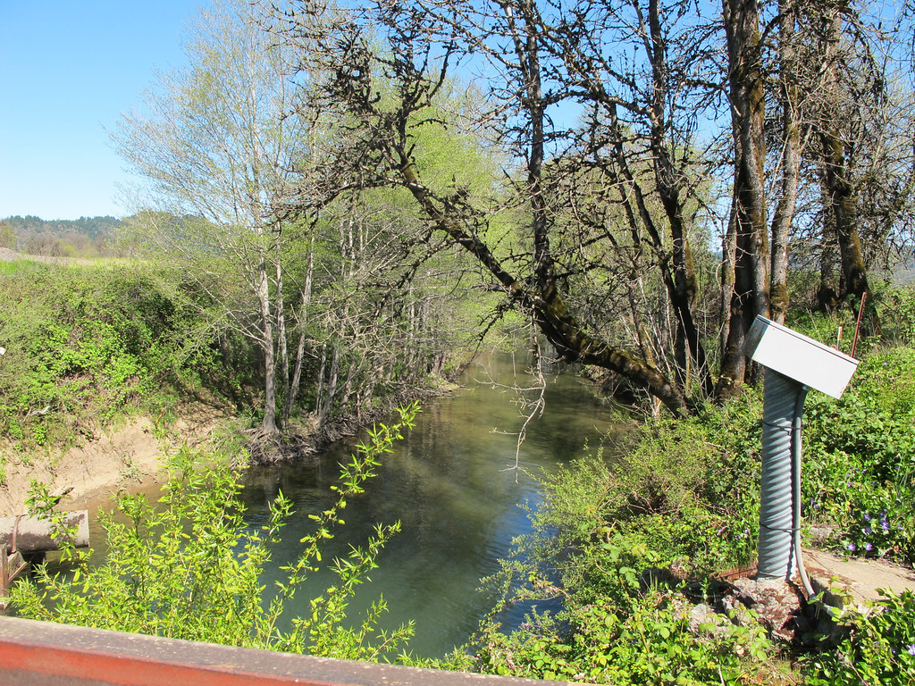 Description of . Looking north from the Willits sewer plant bridge looking at the start of Outlet Creek. The viaduct will cross over this bridge.