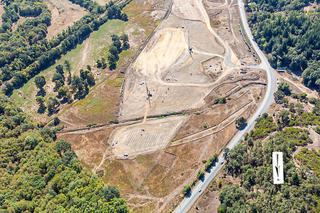 Description of . Northern interchange view of the wick drain field; Willits bypass construction overflight Sept. 5; Pilot Mike Smith; photographer Steve Eberhard/TWN