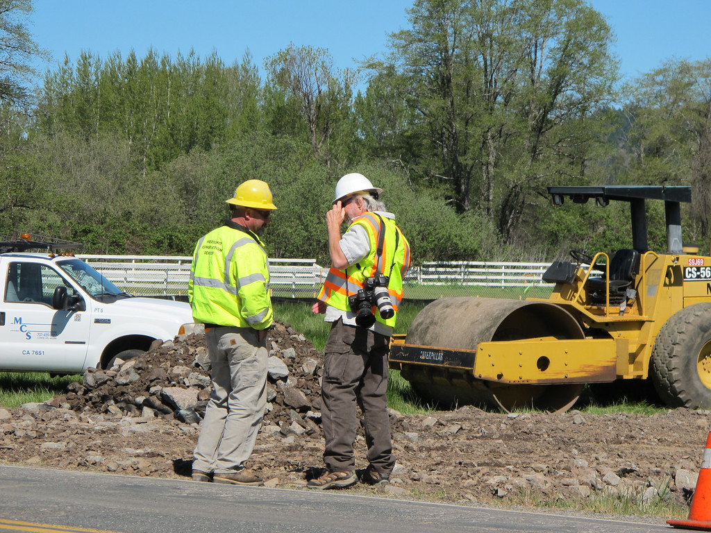 Description of . CalTrans worker chats with TWN Photographer Steve Eberhard at the work site along Hearst Willits Road.