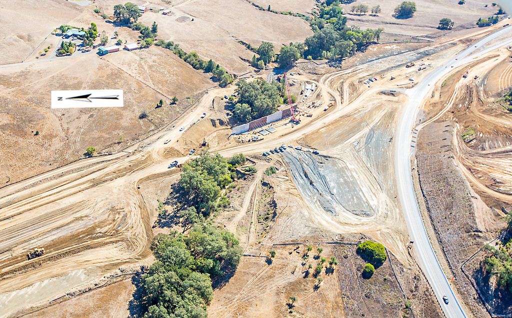 Description of . The southern interchange showing the large retaining wall at Haehl Creek. Willits bypass construction overflight Sept. 5; Pilot Mike Smith; photographer Steve Eberhard/TWN