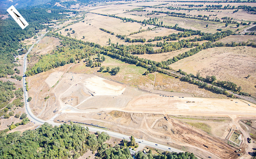 Description of . Another view of northern interchange. Willits bypass construction overflight Sept. 5; Pilot Mike Smith; photographer Steve Eberhard/TWN