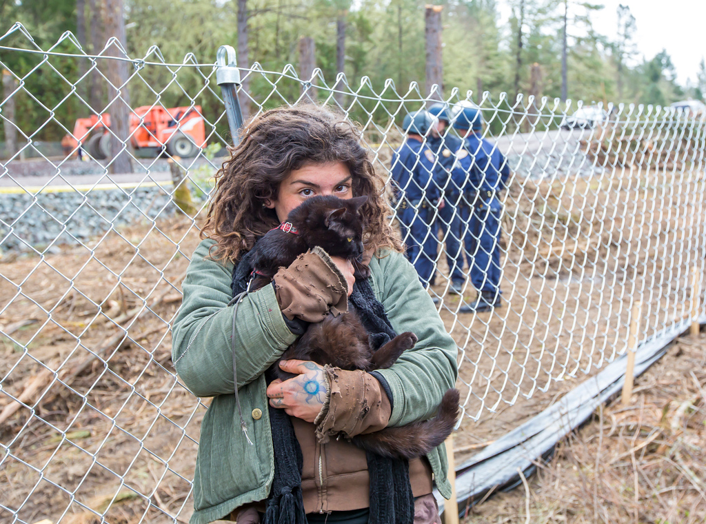 . Tara Dragani hugs her cat after the CHP officers handed it to her. The officers retrieved the cat from one of the platforms in the tree. Photo by Steve Eberhard