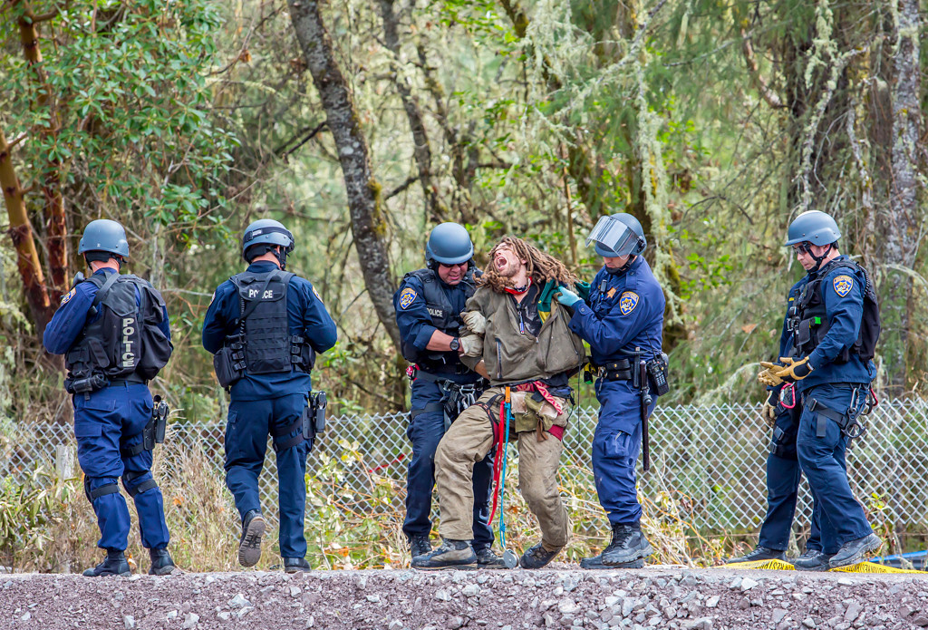 . Katz, in obvious pain, is being taken to a waiting cruiser for a trip to the hospital and then to jail. Katz is currently in Mendocino County Jail with bail set at $60,000. Photo by Steve Eberhard