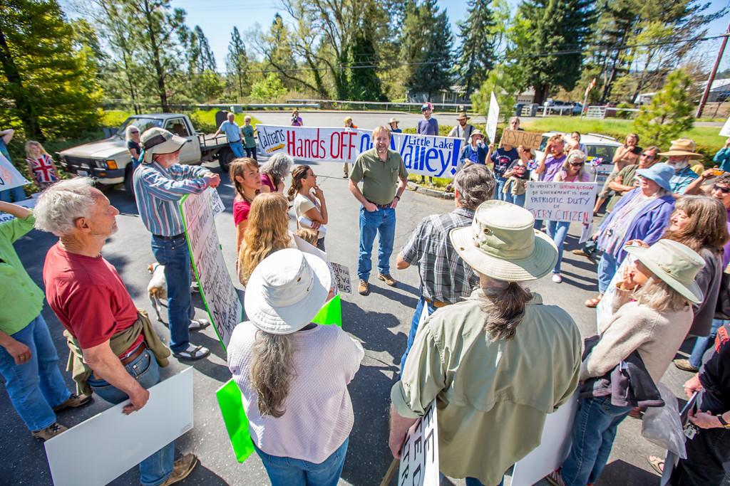 . Protesters confront CalTrans spokesman Phil Frisbie who stays and answers questions until the crowd disperses. Photo by Steve Eberhard TWN 9 Willits bypass protesters April 23, 2013 in front of the Willits CalTrans bypass project office at corner of Baechtel and E. Hill roads.