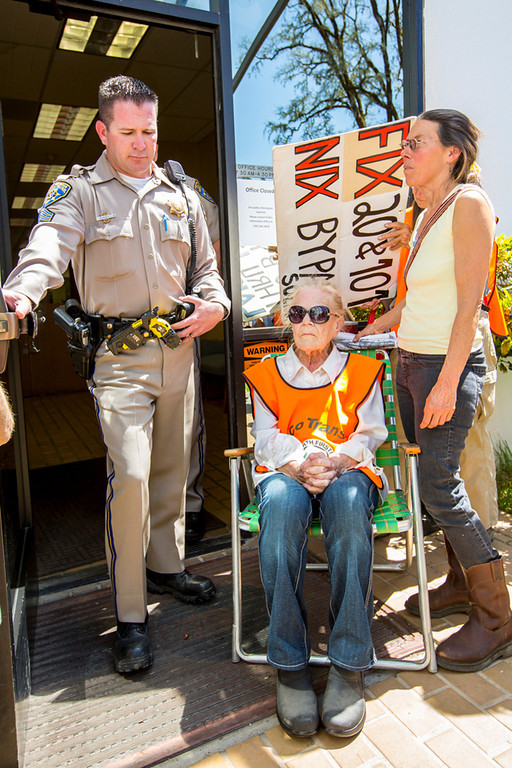 . Willits resident Mary Korte, 78, was sitting in her chair at the door to the CalTrans office and refusing to move. CHP told her if she did not move she would be arrested. She didn\'t move and she was.  Photo by Steve Eberhard TWN 1-22 Willits bypass protesters April 23, 2013 in front of the Willits CalTrans bypass project office at corner of Baechtel and E. Hill roads.